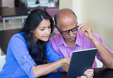 A father and daughter looking over a home inspection report.